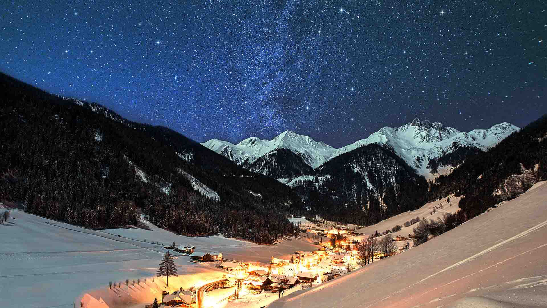 Bright snowy city surrounded by mountains