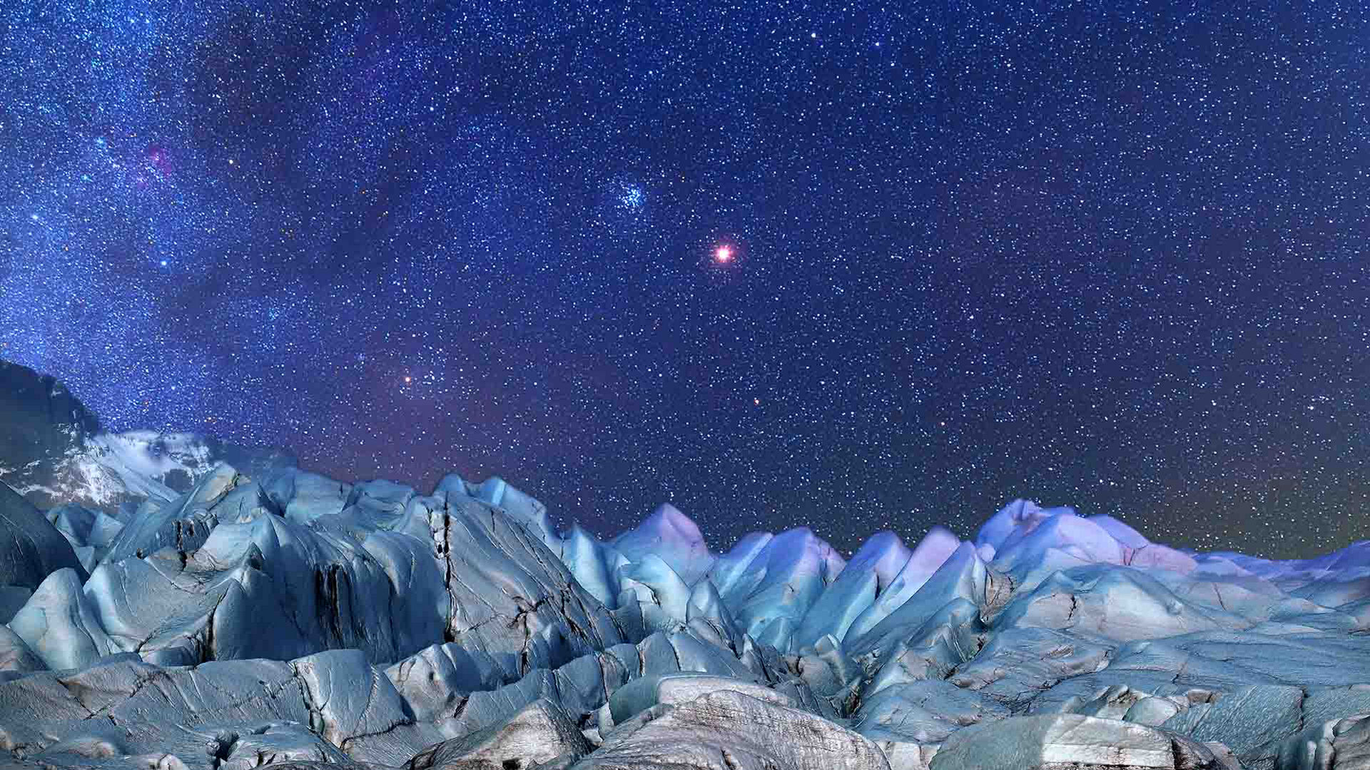 Mars and Pleiades over rocks
