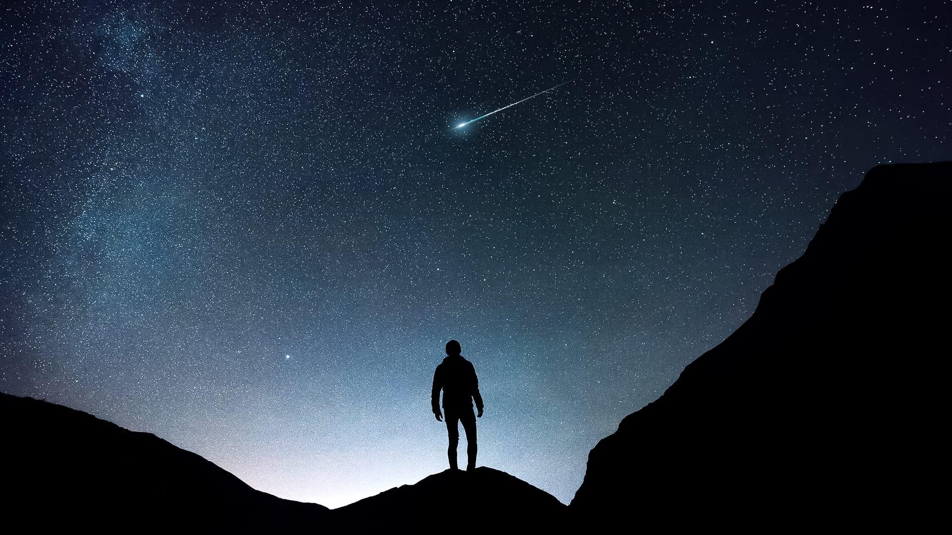 Man watching the night sky