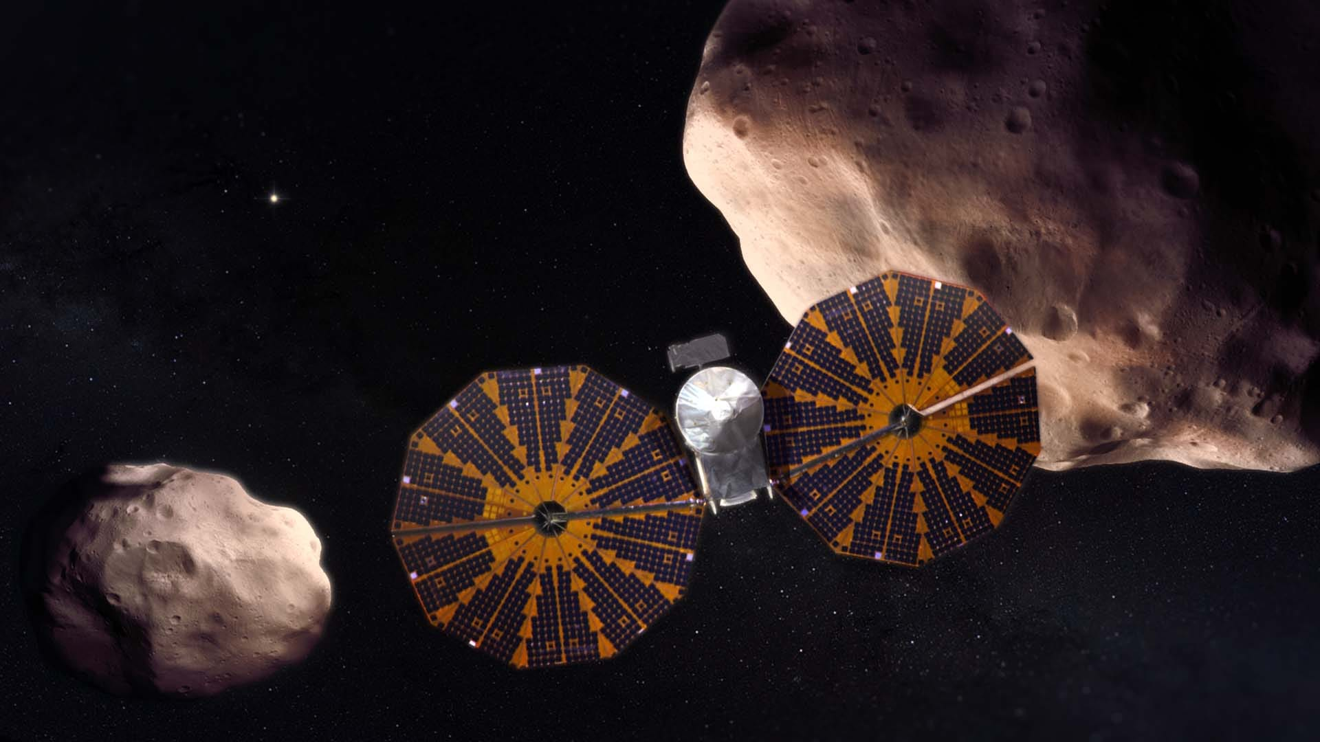 Lucy spacecraft flying past the Trojan asteroids